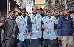 December 18, 2018 - Srinagar, Jammu & Kashmir, India - Separatist leader Mohd Yaseen Malik and others seen Marching during a protest in Srinagar. Authorities imposed restrictions in many parts of the Kashmir valley to prevent the protest march called by Separatist leaders against the killings of seven civilians recently by Indian forces. (Credit Image: © Idrees Abbas/SOPA Images via ZUMA Wire)