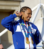 Foto: Colorsport/Digitalsport<br /> NORWAY ONLY<br /> <br /> Kelly Holmes (GBR) with her two Gold Medals, listens to the crowd shouting her name. Trafalgar Square. 18/10/2004.