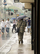 people walking in the rain in downtown New York