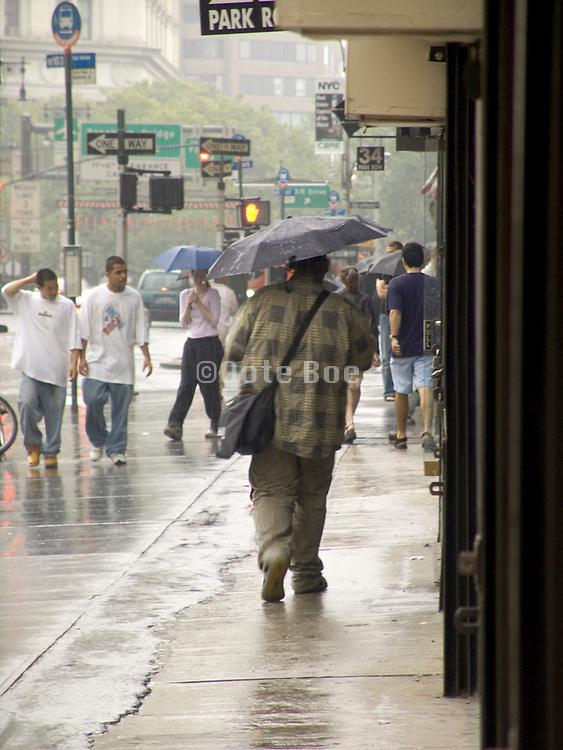 people walking in the rain in downtown New York