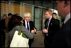 London Mayor Boris Johnson checks his mobile before giving media interviews after giving a speech to urge London's small businesses to profit from the 2020 Games at the East Wintergarden, Canary Wharf, London, United Kingdom. Monday, 9th September 2013. Picture by Andrew Parsons / i-Images