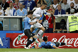 (l-r) Nahitan Nandez of Uruguay, Cristiano Ronaldo of Portugal, Martin Caceres of Uruguay during the 2018 FIFA World Cup Russia round of 16 match between Uruguay and at the Fisht Stadium on June 30, 2018 in Sochi, Russia