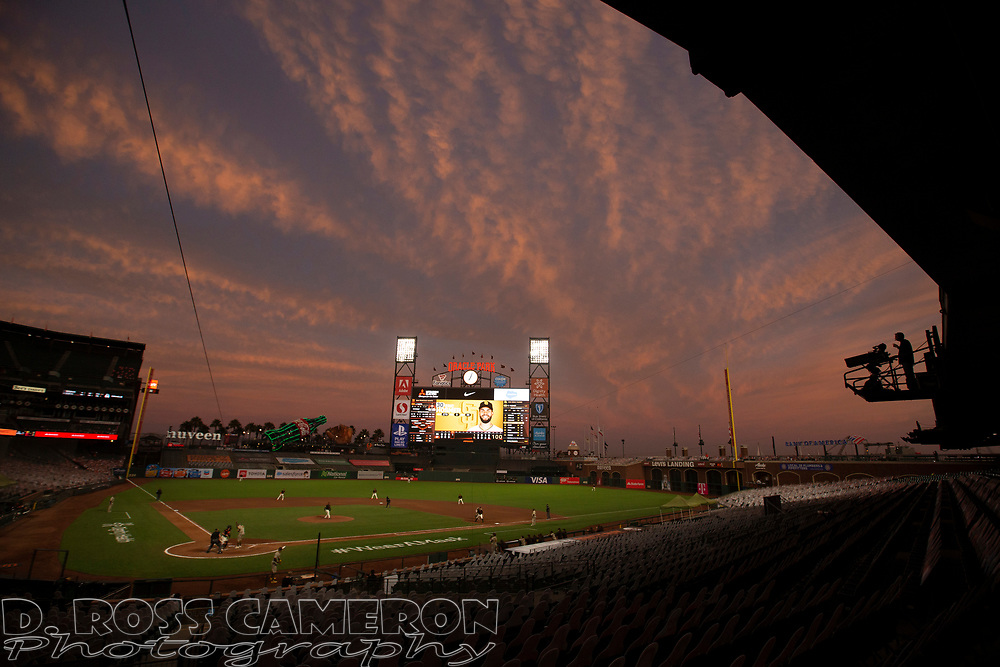The sunset paints an impressionist painting over Oracle Park during the fourth inning of a Major League Baseball game between the San Francisco Giants and San Diego Padres on Saturday, Sept. 26, 2020 in San Francisco, Calif. (D. Ross Cameron/SF Chronicle)