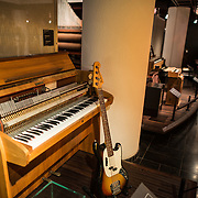 An organ and bass guitar on display at the Musical Instrument Museum in Brussels. The Musee des Instruments de Musique (Musical Instrument Museum) in Brussels contains exhibits containing more than 2000 musical instruments. Displays include historical, exotic, and traditional cultural instruments from around the world. Visitors to the museum are given handheld audio guides that play musical demonstrations of many of the instruments. The museum is housed in the distinctive Old England Building.