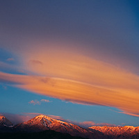 A sunrise lights 'Sierra Wave' lenticular clouds over the Sierra Nevada.