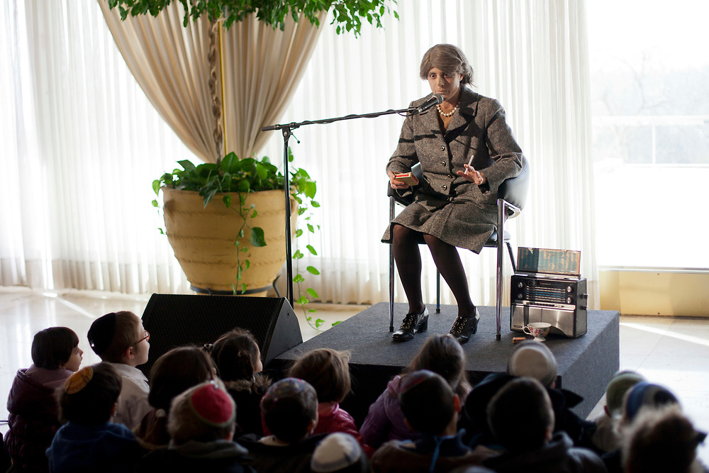 An actor dressed up as former Israeli prime minister Golda Meir performs in front of a group of children visiting the Knesset, as part of a series of events held at the Israeli parliament, marking it's 63rd birthday, on February 8, 2012.