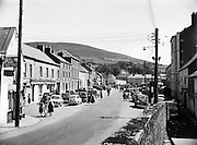 """Fair Day at Baltinglass.17/06/1957..Baltinglass is a town in south-west County Wicklow, Ireland. It is situated on the River Slaney near the border with County Carlow and County Kildare, on the N81 road. Its Irish name means """"the way of Conglas"""", Conglas being a member of the mythological warrior collective, the Fianna. A previous Irish-language name for the village, bringing to mind its monastic past, was Mainistir an Bhealaigh."""