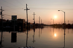 05 Sept  2005. New Orleans, Louisiana. Post hurricane Katrina.<br /> Animal rescue boat.  The sun drops in the horizon over a devastated New Orleans.<br /> Photo; ©Charlie Varley/varleypix.com