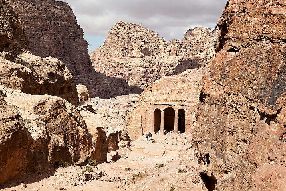 Two tourists step out of the Garden Temple in Petra, Jordan.