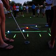 A glow in the dark putting contest in Scottsdale, Arizona.