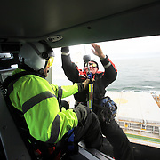 Mike Haglund, the president of the Oregon State Bar for 2013, is a maritime lawyer who represents the Columbia River Bar Pilots. The pilots, based out of Astoria, steer large ships over the treacherous Columbia bar. Russ Scheel lifts bar pilot Matteo Philip from a ship into bar pilots' helicopter, the purchase of which Haglund negotiated.