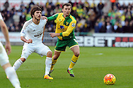 Swansea City's Alberto Paloschi (l) challenges Norwich's Jonny Howson. Barclays Premier league match, Swansea city v Norwich city at the Liberty Stadium in Swansea, South Wales on Saturday 5th March 2016.<br /> pic by  Carl Robertson, Andrew Orchard sports photography.