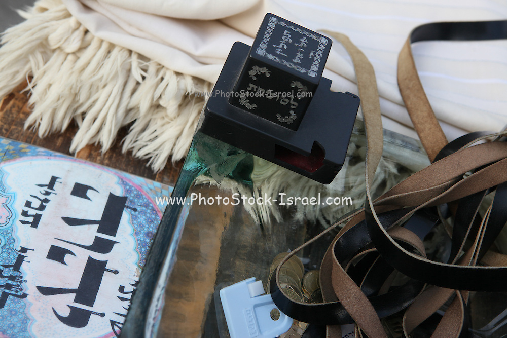 Tifillin are either of two boxes containing Biblical verses and black, leather straps attached to them which are used in rabbinic Jewish prayer. They are an essential part of morning prayer services, and are worn on a daily basis (except the Sabbath and festivals) by religious Jewish males above the age of 13 years