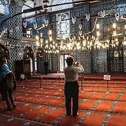 Tourists take photos inside Istanbul's Rustem Pasha Mosque near the Spice (Egyption) Market.