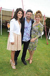 Left to right, KATIE MELUA, ANDY SERKIS and LORRAINE ASHBOURNE at the Cartier Queen's Cup Polo Final, Guards Polo Club, Windsor Great Park, Berkshire, on 17th June 2012.