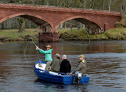 Pictured: adventurer Polly Murray casts the first fly of the new season.<br /> <br /> Anglers from all over the country arrived in Kinclaven, Perthshire for the first day of the new salmon fishing season on the River Tay, which is marked with whisky and sees the anglers led to the water by pipers.<br /> <br /> <br /> © Dave Johnston / EEm