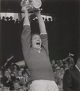 Cork captain, Martin O'Doherty raises the McCarthy Cup in 1977.