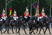 Members of the The Queens Life Guard red tunics and the Blues and Royals blue tunics change the guard during the daily ceremonial in Horse Guards Parade, on 11th June 2019, in London, England. Life Guards have stood guard at Horse Guards, the official entrance to St James and Buckingham Palace, since the Restoration of King Charles II in 1660.