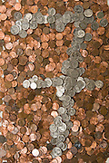 Base 10 numbers constructed from pennies and various silver-tinted currency.