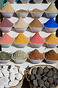 Rows of various colorful spices in bowls in a market in Cairo, Egypt
