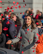 Laura Wright throws poppies in the fountain - Silence in the Square oraganised by the British Legion in Trafalgar Square  - 11 November 2016, London.