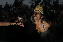 ARAMBOL, GOA,INDIA;FEBRUARY 27: Foreign tourists and travelers dance at a carnival on the beach in Arambol, Goa in India February 27, 2006. (Ami Vitale)