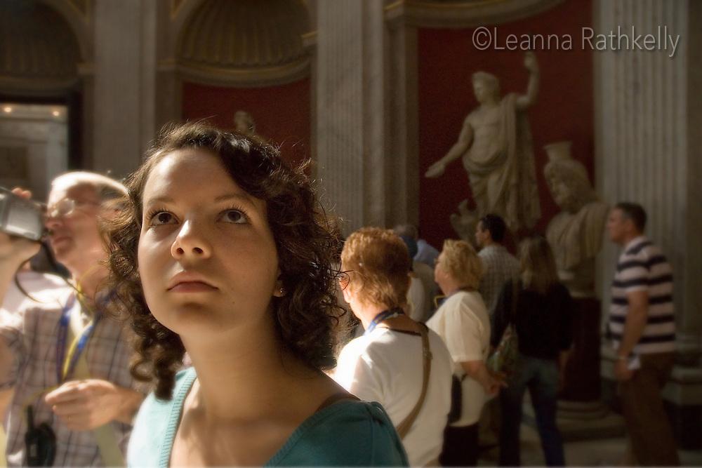 Girl, 14, gazes at Roman statues in Vatican Museum