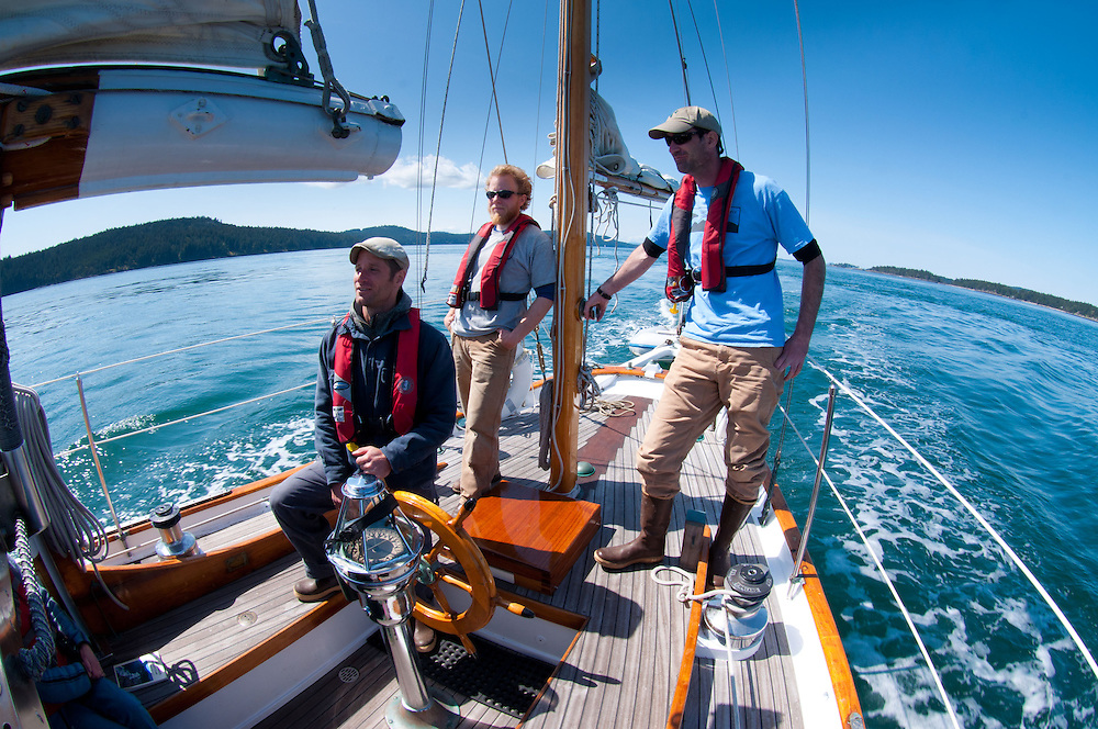 Captain Kevin with Kris and Jeff Aboard Orion Sailing Into the San Juan Islands, Puget Sound, Washington