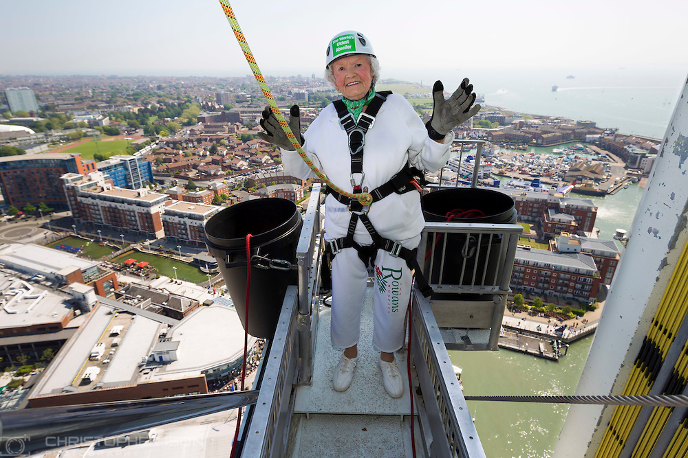 140518 ISON Doris Long Abseil <br /> Intrepid centenarian Doris Long MBE steps out onto the platform before abseiling down the 130 metre tall Spinnaker Tower in Portsmouth today, on her 100th Birthday. She performed the feat to raise funds for local charity, The Rowans Hospice and it is her 15th abseil. Daring Doris took up abseiling at 85 and today broke her own record of being the oldest person to abseil. Picture date Sunday 18th May, 2014.<br /> Picture by Christopher Ison. Contact +447544 044177 chris@christopherison.com