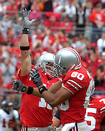 MORNING JOURNAL/DAVID RICHARD.Ohio State split end Anthony Gonzalez, left, is congratulated by teammate Brian Robiske after Gonzalez' 15-yard touchdown catch yesterday in the first quarter.