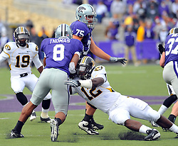 Nov 14, 2009; Manhattan, KS, USA; Missouri linebacker Sean Weatherspoon (12) makes the tackle on Kansas State running back Daniel Thomas (8) in the second half at Bill Snyder Family Stadium. The Tigers won 38-12. Mandatory Credit: Denny Medley-US PRESSWIRE