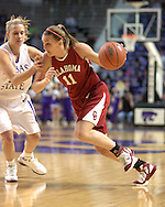 Oklahoma guard Laura Andrews (R) drives against pressure from Kansas State's Claire Coggins (L), during the first half at Bramlage Coliseum in Manhattan, Kansas, February 21, 2006.  The 9th ranked Sooners defeated K-State 78-64.