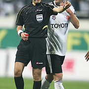 Referee's Cuneyt CAKIR (L) during their Turkish Superleague Derby match Besiktas between Galatasaray at the Inonu Stadium at Dolmabahce in Istanbul Turkey on Sunday, 20 November 2011. Photo by TURKPIX