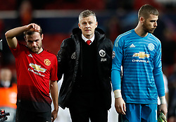 Manchester United caretaker manager Ole Gunnar Solskjaer with Juan Mata (left) and after defeat during the UEFA Champions League round of 16, first leg match at Old Trafford, Manchester.