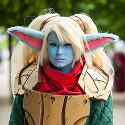 """© Licensed to London News Pictures. 29/05/2016. London, UK. A girl dresses as """"Poppy"""" from the game, League of Legends, as cosplayers visit the Excel Centre on the last day of the popular MC Comic Con, a three day event celebrating games, anime, movies and more. Photo credit : Stephen Chung/LNP"""
