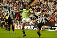Fotball<br /> England 2005/2006<br /> Foto: SBI/Digitalsport<br /> NORWAY ONLY<br /> <br /> Newcastle United v Deportivo La Coruna<br /> Intertoto Cup.<br /> 03/08/2005.<br /> Deportivo's Joan Capdevila (C) gets a shot in on goal despite the close attentions of Newcastle's Steven Taylor
