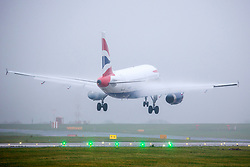 © Licensed to London News Pictures. 28/11/2018. Leeds UK. An British Airways aircraft lands in strong winds & rain at Englands highest airport, Leeds Bradford International. Photo credit: Andrew McCaren/LNP