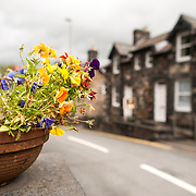 Betws-y-Coed Village Street with Flowers. The village of Betws-y-Coed in the heart of the Snowdonia National Park is a popular base for hikers heading into the surround mountains.
