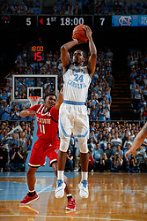 CHAPEL HILL, NC - FEBRUARY 05: Kenny Williams #24 of the North Carolina Tar Heels shoots the ball during a game against the North Carolina State Wolfpack on February 05, 2019 at the Dean Smith Center in Chapel Hill, North Carolina. North Carolina won 113-96. North Carolina wore retro uniforms to honor the 50th anniversary of the 1967-69 team. (Photo by Peyton Williams/UNC/Getty Images) *** Local Caption *** Kenny Williams