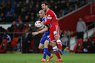 Conor Sammon of Ipswich gets a flick on the ball ahead of Sean Morrison of Cardiff.<br /> <br /> Skybet Football League Championship match, Cardiff City v Ipswich Town at the Cardiff city stadium in Cardiff, South Wales on Tuesday 21st October 2014<br /> pic by Mark Hawkins, Andrew Orchard sports photography.