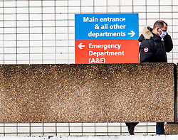 © Licensed to London News Pictures. 13/02/2020. London, UK. A man walks past St Thomas's Hospital this morning as the first London Coronavirus victim is currently being treated there. Photo credit: Alex Lentati/LNP