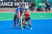 Giuliana Ruggieri of Italy takes on South Africa's Vuyisanani Mangisa in the penalty shoot out during their match in the Investec Hockey World League Semi Final 2013, Quintin Hogg Memorial Sports Ground, University of Westminster, London, UK on 29 June 2013. Photo: Simon Parker
