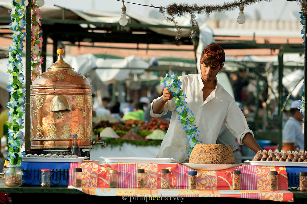 A cake seller at his stall in the Djemaa el Fna in the medina of Marrakech, Morocco