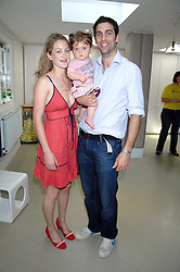 HUGH & ROSE VAN CUTSEM and their daughter GRACE at a party to celebrate the 21st birthday of the children's charity Starlight held at Maggie & Rose, 58 Pembroke Road, London W8 on 12th May 2008.<br />