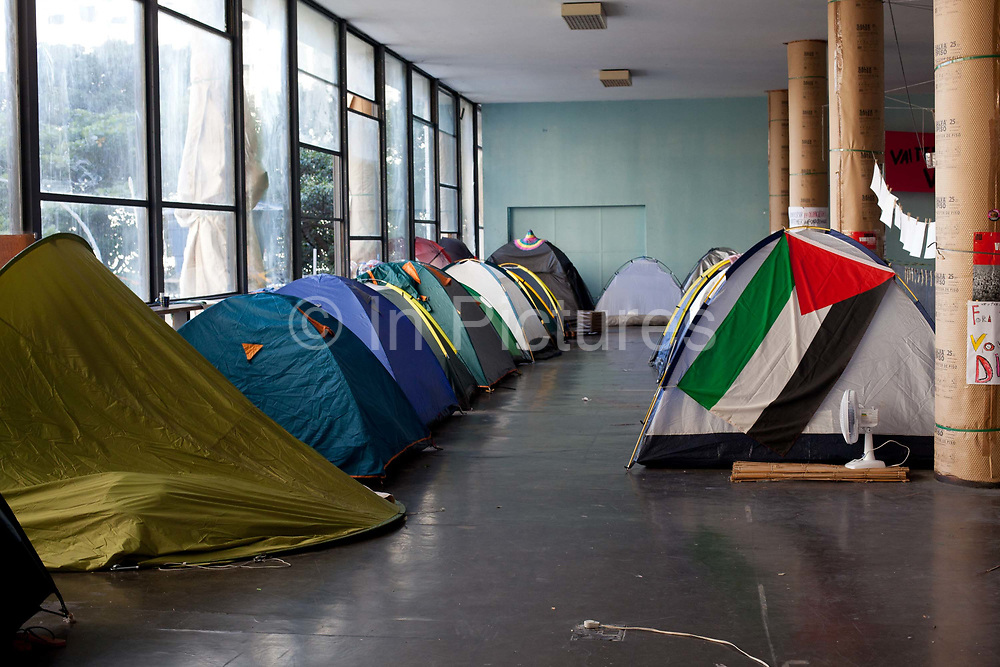 Tents of the occupaants. The Ministry of Culture in Rio de Janeiro has been occupied since 15th May 2016. Originally as a protest in response to the interim President Michel Temer cutting the Ministry, even though it has been re-instated, the occupation continues. Dozens of protesters are resident here, living in tents shelters inside the building. The space has been host to a multitude of self organised cultural events, from music to discussions to yoga, and even some University lecturers holding their classes here, it is a hotbed of activity.