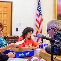 042115       Cable Hoover<br /> <br /> Defeated mayoral candidate George Galanis, right, leans over the bench to watch poling officials recount early voting ballots Tuesday at City Hall.