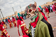 """Dec. 12, 2009 -- PHOENIX, AZ: A """"demon"""" performs during a procession to honor the Virgin of Guadalupe at St. Catherine of Siena Catholic Church in Phoenix, AZ. Most of the members of the church are Hispanic and Dec. 12, Virgin of Guadalupe Day, is one of the church's most important holy days. The Virgin of Guadalupe appeared to Juan Diego, a Mexican peasant, on Dec 9, 1531, on a hillside near Mexico City. She is the """"Queen of Mexico"""" and """"Empress of the Americas"""" and revered throughout Latin America. Matachine dancers do battle with the demon to protect the Virgin of Guadalupe.  Photo by Jack Kurtz"""