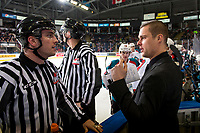 KELOWNA, CANADA - JANUARY 26:  Lineman Tim Plampndon stands at the bench speaking to Kelowna Rockets' assistant coach, Adam Brown during a time out against the Vancouver Giants on January 26, 2019 at Prospera Place in Kelowna, British Columbia, Canada.  (Photo by Marissa Baecker/Shoot the Breeze)