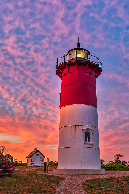 Nauset Light is one of the most iconic Cape Cod lighthouses. It is located in the town of Eastham, Massachusetts next to Nauset Beach and not far from Coastguard Beach along the Cape Cod National Seashore. Visiting Cape Cod and the Islands is always a lot of fun. I finally was able to head out to photograph Nauset Lighthouse at sunset when the sky exploded into beautiful colors. <br /> New England Cape Cod lighthouse fine art photography images are available as museum quality photography prints, canvas prints, acrylic prints or metal prints. Fine art prints may be framed and matted to the individual liking and decorating needs:<br /> <br /> https://juergen-roth.pixels.com/featured/nauset-lighthouse-juergen-roth.html<br /> <br /> All New England photos are available for photography image licensing at www.RothGalleries.com. Please contact Juergen with any questions or request. <br /> <br /> Good light and happy photo making!<br /> <br /> My best,<br /> <br /> Juergen