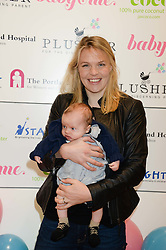 Olympic Gold medal winning rower ANNA WATKINS and her son WILLIAM at the Plusher Fair, Lindley Hall, Royal Horticultural Halls, Vincent Square, London, on 9th November 2013.